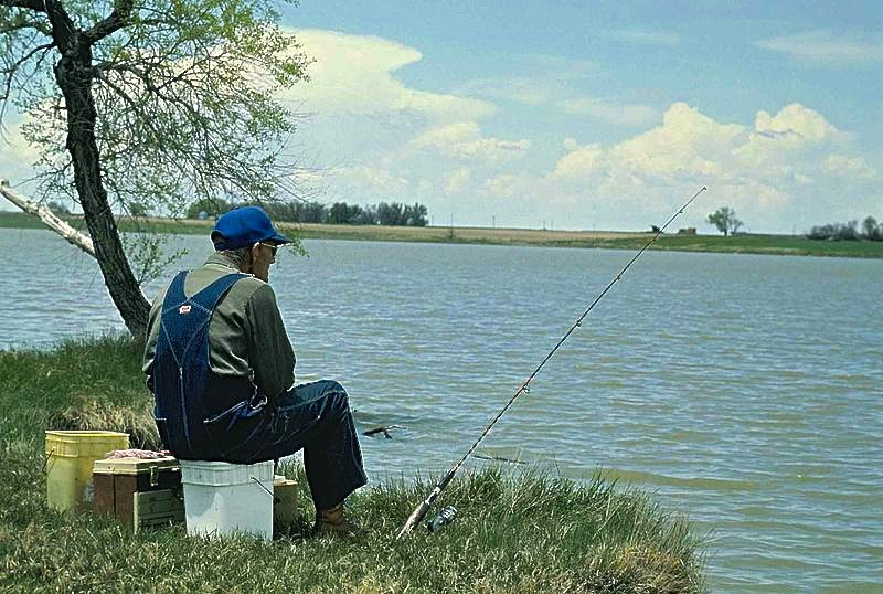 Old_man_fishing_US_Fish_and_Wildlife_Service