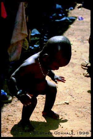 Baby sitting on legs