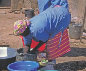 gokhale-method-african-woman-hiphinging-bending-laundry
